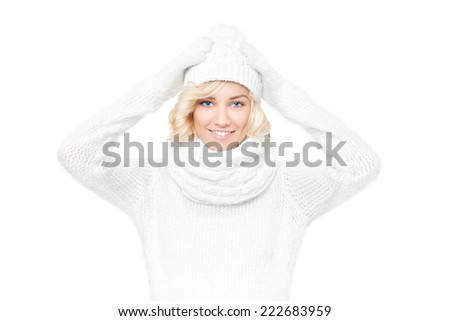Beautiful young blond woman witch winter hat and scarf-winter portrait