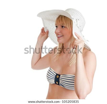 beautiful young blond woman with bikini and sun hat - stock photo