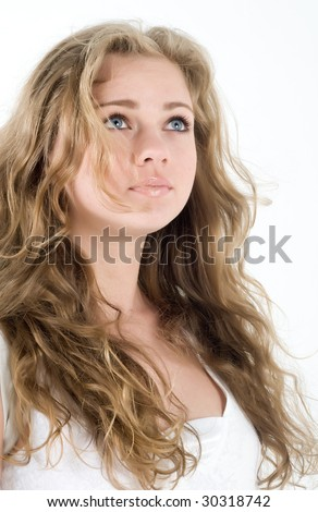 Beautiful young blond woman with long curl hair look up