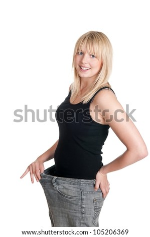 beautiful young blond woman with oversized pants - stock photo