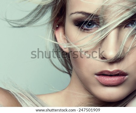 beautiful young blond woman with perfect skin posing with flawless make up  - stock photo