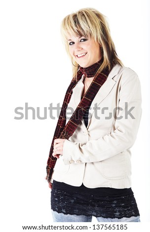 Beautiful young blonde caucasian woman in a light beige jacket and brown scarf against a white background