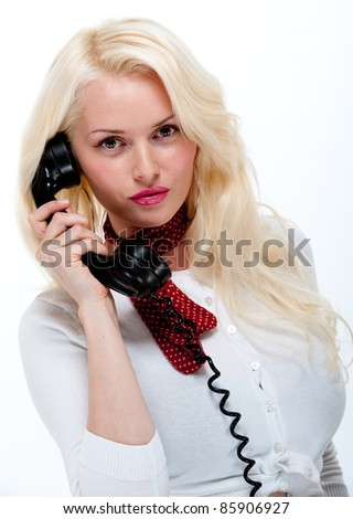 Beautiful young blonde female on telephone isolated against white