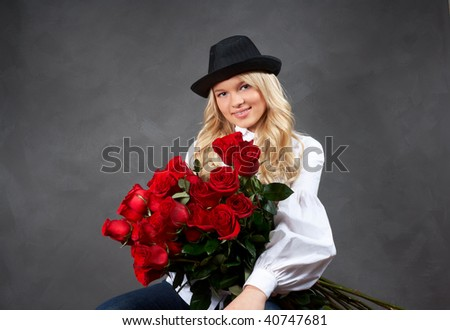 beautiful young blonde girl with a bouquet of roses