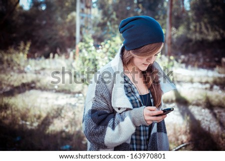 beautiful young blonde hipster stylish woman outdoor - stock photo