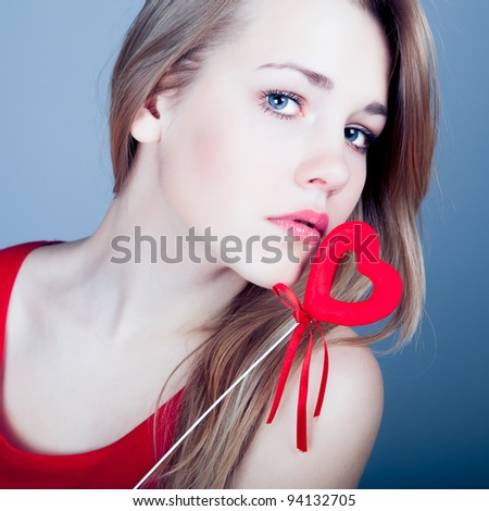 beautiful young blonde with red heart