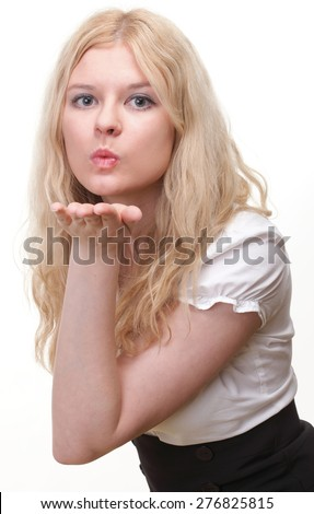 beautiful young blonde woman blowing a kiss isolated - stock photo