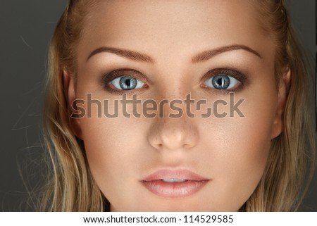 Beautiful young blonde woman face with perfect skin close-up portrait - stock photo