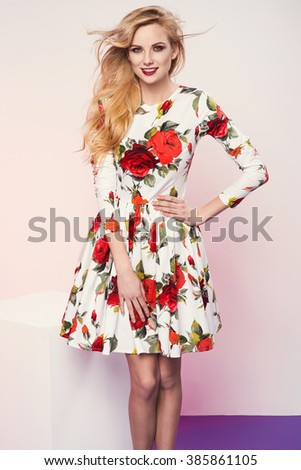 beautiful young blonde woman in nice spring dress posing in a studio. Fashion photo - stock photo
