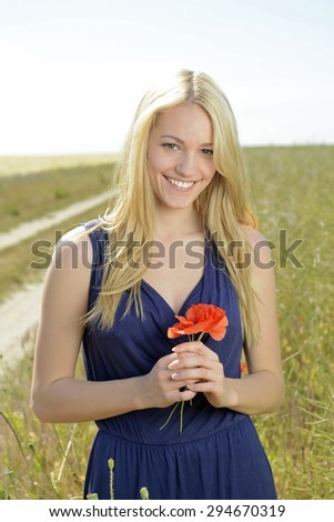 stock photo beautiful young blonde woman standing in corn field 294670319