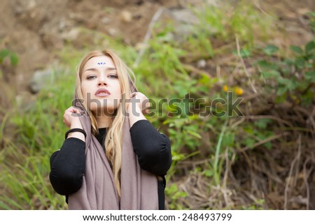 Beautiful young blonde woman with gemstones on her forehead.Yoga woman,healthy spiritual woman with veil/ scarf.Calm mysterious beauty woman. - stock photo