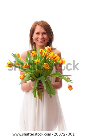 Beautiful young blonde woman with tulips bouquet on white background