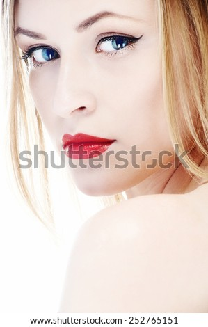 beautiful young blue eyes blond woman with clean face and red lips close-up portrait