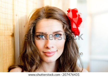 beautiful young blue eyes lady with shadow from window blinds on light copy space background, closeup portrait - stock photo
