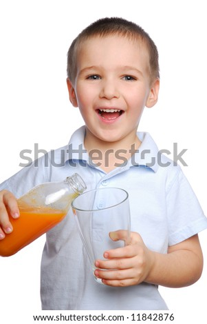 Beautiful young boy holding bottle of carrot juice - stock photo