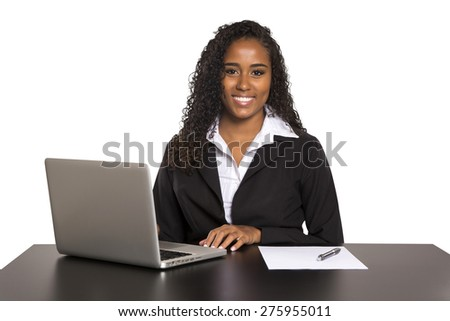 Beautiful young brazilian woman smiling and doing some work on her laptop, on white background - stock photo
