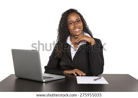 Beautiful young brazilian woman smiling and doing some work on her laptop, on white background