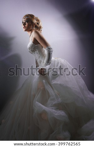 beautiful young bride in a luxurious wedding dress