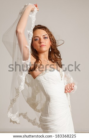 beautiful young bride in studio - stock photo