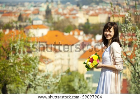 beautiful young bride on the background of Prague - stock photo