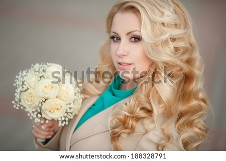 Beautiful young Bride outdoor, woman with wedding makeup and hairstyle retro style. Blonde bride with gorgeous curly hair at sunset - soft focus.  - stock photo