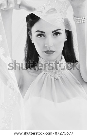 beautiful young bride wearing  wedding dress in retro fashion style isolated on white background in studio - stock photo