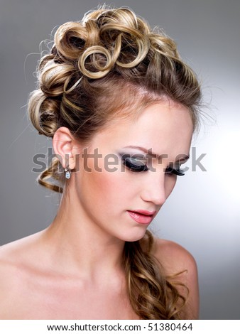 Beautiful young bride with blue make-up and ringlet wedding hairstyle - stock photo