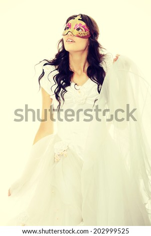 Beautiful young bride with Venice mask. Isolated on white. - stock photo
