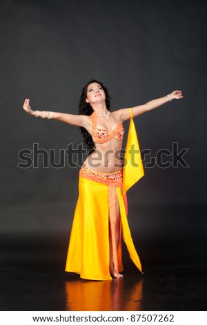 Beautiful young brunette belly dance woman
