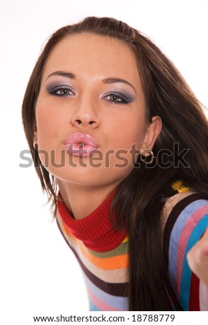 Beautiful young brunette blowing kiss to somebody - stock photo