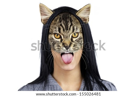 Beautiful young brunette cat woman sticking her tongue out  - stock photo