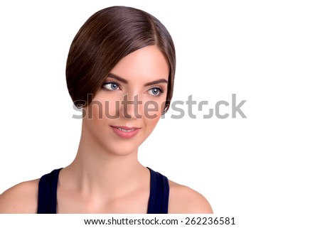 Beautiful Young Brunette Girl looking away - stock photo
