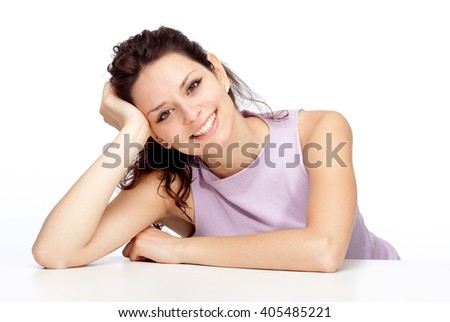 beautiful young brunette girl smile lean on white table isolated on white - stock photo
