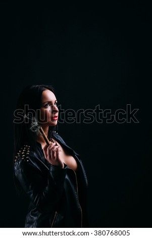 Beautiful young brunette girl with cigarette