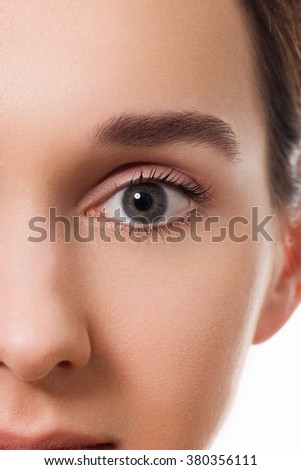 Beautiful young brunette girl with perfect eyebrows and clear skin - stock photo