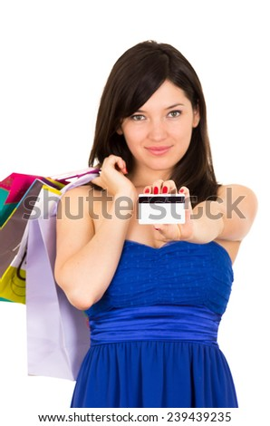 beautiful young brunette happy woman holding shopping bags and credit card isolated on white - stock photo