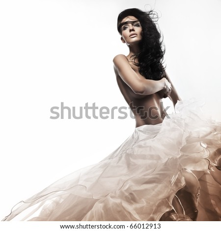 Beautiful young brunette in a romantic pose - stock photo