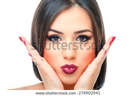Beautiful young brunette posing with hands on cheeks - stock photo
