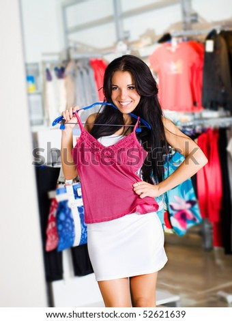 Beautiful young brunette shopping - stock photo