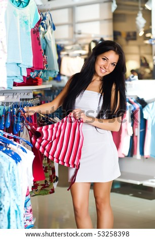 Beautiful young brunette shopping