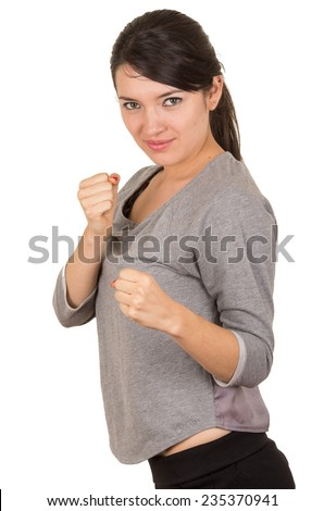 Beautiful young brunette strong confident girl posing punching fighting position isolated on white - stock photo