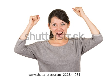 Beautiful young brunette sweet excited girl posing with arms up winning isolated on white - stock photo