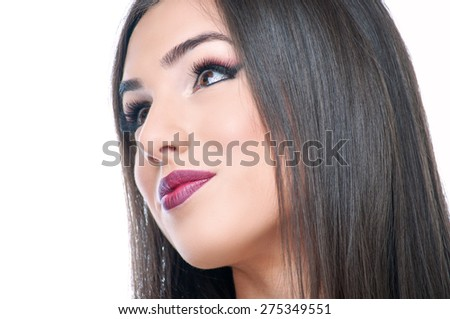 Beautiful young brunette with makeup - stock photo