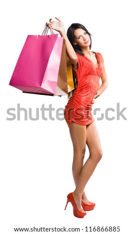 Beautiful young brunette with shopping bags. - stock photo