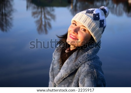 Beautiful young brunette with winter hat
