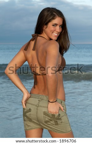 Beautiful Young Brunette Woman in Brown Bikini Top Looking Over Shoulder - stock photo