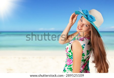 Beautiful young brunette woman on beach. Free space for text - stock photo