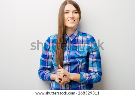 beautiful young brunette woman posing holding hair with hands isolated on white - stock photo