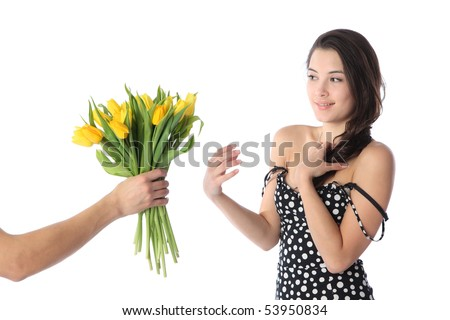 Beautiful young brunette woman receiving gift bouquet of fresh yellow tulip flowers. Isolated over white background.