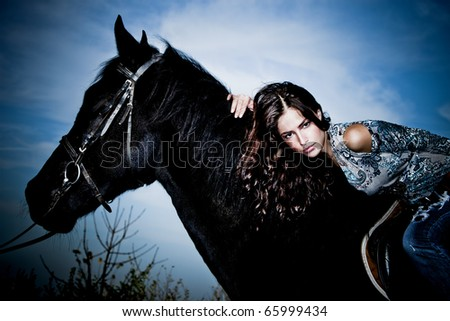 beautiful young brunette woman  ride black horse - stock photo